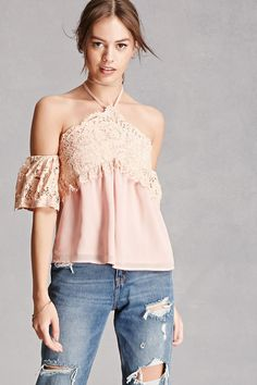 A woven self-tie halter top featuring a partial eyelash lace overlay, an open back with a sheer bottom, an elasticized back waist, an open-shoulder design, and short flounce lace sleeves with elasticized arm bands. This is an independent brand and not a Forever 21 branded item. (This item runs small, please size up.)