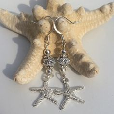 A personal favorite from my Etsy shop https://www.etsy.com/listing/236527960/starfish-earrings-sparkle-beach-glass