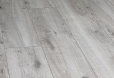 Your basement flooring options are not really any different from the flooring options elsewhere in your home. Everything from ceramics to hardwood, all are possible choices for your basement floor… Best Wood Flooring, Basement Flooring Options, Parquet Flooring, Hardwood Floors, Grey Kitchen Tiles, Grey Wood Tile, Wood Tiles, Wood Floor Colors, Light Grey Kitchens