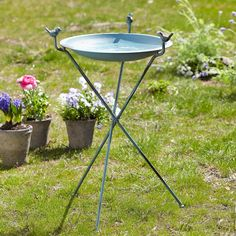 """BATHTIME FOR BLUEBIRDS--And all your feathered friends! Three little birdies hold a shallow, antiqued blue bowl on a tripod base. Handcrafted of recycled metal, it can be used as a bird bath or feeder. Imported. 18-1/4"""" dia. x 28""""H."""