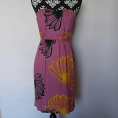 """Anthro Sariah Strapless Dress Anthropologie Sariah strapless dress Fully Lined 100% Rayon Back zipper Small back slit Beautiful Mauve/Pink/Purple color with navy and yellow floral print Size 2 Worn once or twice EUC. There is a very small white mark on the back of the dress as shown in picture. Not noticeable while wearing. Measurements laying flat: Underarm to underarm: 14.5"""" Waist: 13"""" Length: 29"""" Anthropologie Dresses"""