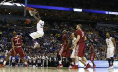 Kansas forward Jamari Traylor delivers a dunk against Eastern Kentucky during the second half on Friday, March 21, 2014 at Scottrade Center in St. Louis. #KU