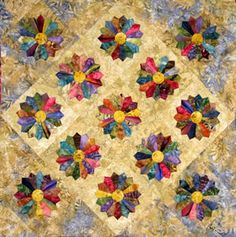Dresden Plate quilt, using rich, deep batik colors.