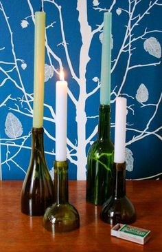 How about cut off bottles like these set in a concrete base,;in a straight line or round or square like a chandelere?