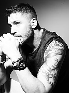 Tom Hardy's arms are made for bear hugs or bare naked hugs...just a random thought..