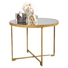 A stylish canvas for fresh bouquets or a stack of fashion magazines, this chic side table showcases a gold-finished iron base and mirrored top. ...