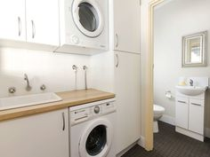 perfect laundry, washing machine under the bench gives you extra working bench space! Garage Laundry, Tiny Laundry Rooms, Laundry Room Bathroom, Laundry Room Design, Bathroom Design Small, Downstairs Bathroom, Bathroom Renos, Washroom, Laundry Room Inspiration
