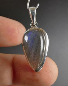 Labradorite cabochon from Madagascar mounted in sterling silver This is unique item you get what is on the picture Free gift box included Setting silver Sterling silver Dimension mm 35 x 15 x 8 mm overall size including setting/bail Weight 5 Silver Pendants, Stone Pendants, Madagascar, Labradorite, Free Gifts, Gemstone Rings, Pendant Necklace, Sterling Silver, Box