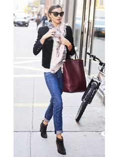Miranda Kerr WORE: Mulberry scarf, Rag & Bone jeans and top, Celine bag, and Dior sunglasses