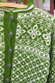 green and white knitted sweater