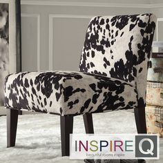"""I really like cows -and though this is not a """"timeless"""" or perhaps even """"tasteful"""" fabric - this type of chair will be easy to reapolster when sensabilities return ;)"""