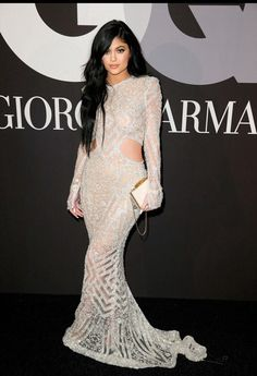 Kylie Jenner from 2015 Grammys After-Party Looks.The youngest of the Kardashian-Jenner clan wore a slim-fitting (and ultra-sheer) metallic gown with side cut-outs and bell-shaped sleeves. Kendall E Kylie Jenner, Kylie Jenner Style, Long Sleeve White Gown, Estilo Kylie Jenner, Mode Glamour, Tyga, Giorgio Armani, Dress To Impress, Beautiful Dresses