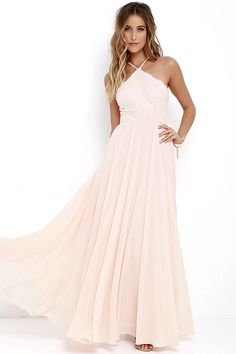 The Everlasting Enchantment Light Peach Maxi Dress will have admirers under your spell! Adjustable spaghetti straps support a lacy halter bodice, then crisscross at back. Layers of chiffon sprouts from a fitted waist, then sweeps down to an elegant maxi length. Hidden back zipper with clasp.