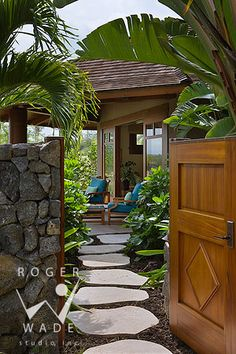 looking through gate down tropical pathway to guest bedroom lanai, private estate, kailua-kona, hawaii, by mclaughlin & associates archticts...