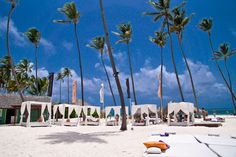 At Gabi Beach beautiful bodies lie perennially on large loungers, sipping passion fruit mojitos under the shade of palm trees. Original photos property of Punta Cana Lifestyle Real Estate. Punta Cana, Bavaro Beach, Golf, Sandy Beaches, Dominican Republic, Beach Club, Palm Trees, Bodies, Dolores Park
