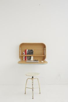 Nubo  manufactured by Ligne Roset // 2013  Nubo, the simple space-saving wall shelf metamorphoses into a treasure box, evocative of a suitcase with its bar of soap-like lines – like the Air France blue fabric travelling case of the 1960s: its rounded cloud shape and its luminous yet warm association of natural oak and sky blue wool fabric also fall into the same vintage Scandinavian register.