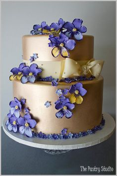 Purple and Yellow Sugar-Paste Pansies accent this Southern Metallic Gold Cake
