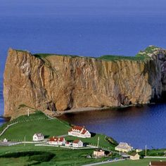 """Rocher Percé, French for """"pierced rock,"""" and one of the most unlikely tourist hot spots in Canada, looms as a constant presence just offshore from Gaspé Peninsula's town of Percé. 
