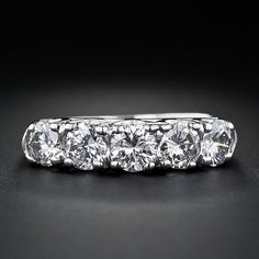Classic Five-Stone Wedding Band- $3,650. Wouldn't want this large but like the setting.
