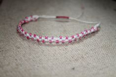 Follow me on Pinterest! This is a very delicate and light weight bracelet.   Made with white cotton and pink glass seed beads. Closure is shambala/macrame style, adjustable, one size.  It is perfect for summer months at the beach, you can wear it in a yoga class, or around town. So light you can wear it anywhere, and you will hardly feel it on your wrist.