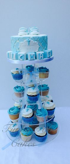 Baby boys christening cupcake tower with booties topper