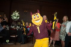 The Arizona State University mascot, Sparky, made an appearance at this wedding! What an awesome idea to have your alma mater mascot show up at your wedding | Lasting Images Photography | villasiena.cc