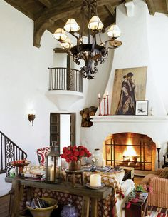 "I can't decide if I favor the rustic ""spanish"" style. I like the fireplace (it's slope, it's ornate fire hole; white walls contrast against dark woods; Spanish Style Homes, Spanish House, Spanish Colonial, Spanish Revival, Mexican Spanish, Style At Home, Casa Magnolia, Cosy Living, Design Lounge"