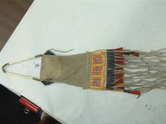 """Nice replica Plains-style strike-a-lite bag with tin cone  and horsehair suspensions, a beautiful flat  quilled body and slats with bear paw design.   Excellent condition. 12"""" + fringe x 4-1/2"""" Unknown maker"""
