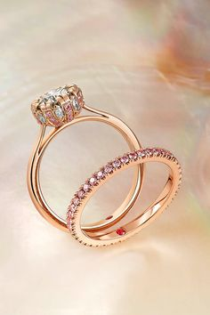 Every ring has a story. Tell yours with us... Rare Pink is here to help you create the perfect engagement ring. Just like this beauty - a rose gold diamond solitaire engagement ring with white and fancy-pink diamond detail in the collet 18 carat rose gold wedding ring with pavé set fancy-pink diamonds.