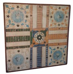 """19th century NEW ENGLAND PARCHEESI GAME BOARD, New Hampshire Parcheesi board. The white ground of the surface is decorated with blue, salmon and green and black, applied molding , one wide board, a square in each corner with a rose surrounded by stars , and the center panel has one a single star in a white circle . Circa 1840-60, Measurements are: 23 1/2"""" x 23 3/4"""" - from Country Treasures"""