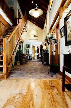 Native pecan floors and stair grace this Truehome created using the Truehome Workshop. Sentient Architecture, LLC.