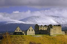 Ruthven Barracks, Cairngorms, Scotland, hill, fort, grass, plinth, reclaimed, marsh, Spring, sunshine, snow, slopes, mou photo