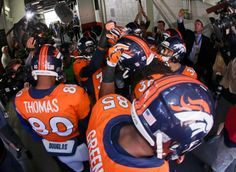The Denver Broncos huddle in the tunnel before the AFC Championship NFL playoff football game. (Charlie Riedel/AP)