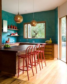 Large transitional u-shaped light wood floor eat-in kitchen photo in Melbourne with flat-panel cabinets, medium tone wood cabinets, blue backsplash, an undermount sink, wood countertops, ceramic backsplash, stainless steel appliances and an island #kitchen #transitional