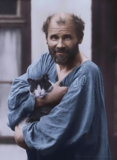 Painter Gustav Klimt with his pet cat, Katzec, in Austria (ca. 1910)