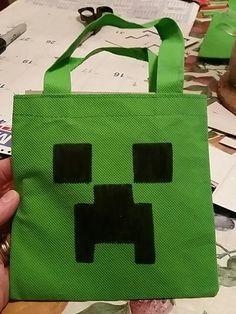 Minecraft loot bags We used bags from the dollar store, a cardboard template, and a Sharpie.