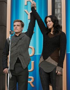 Katnis wears a bulky knit modular sweater in Hunger Games Catching Fire