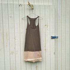Upcycled Tattered Artsy Dress ($ 62.99, via Etsy) an idea to extend a top.
