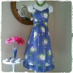 2X's HP! Banana Republic Smocked Floral Sundress Flattering Fit & Flare Blue Banana Republic Dress. Smocked band in upper back, knee length, floral print sundress with adjustable straps and ties in back. Lined. Worn once to The Carolina Cup Horse Race. Excellent condition!  Fully lined. Bundle for discounts! DISCOUNTED BUNDLES AND FREE GIFT WITH EVERY PURCHASE! Banana Republic Dresses