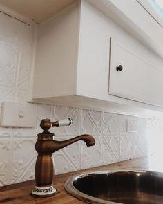 Vintage brass tap compliments the pressed tin splash back. Black Kitchen Taps, Kitchen Sink Taps, Sink Countertop, Kitchen Cupboards, Kitchen Tiles, Caravan Sink, Diy Caravan, Caravan Ideas, Campervan Ideas