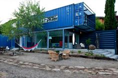 fifteen amazing shipping container homes houses with rattan chairs