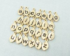 Trending Hot Fashion Jewellry on Alibaba 2015 wholesale Tiny Gold Initial Charm, hand stamped Tiny Initial Charm