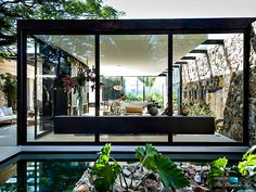 So much of this is genius - rock wall- glass wall - modern architecture indoor/outdoor living spaces Loft 24-7 Casa Cor Exhibition – São Paulo, Brazil – Photo Gallery | The Pinnacle List | Worlds Best Luxury Real Estate and Lifestyle Magazine