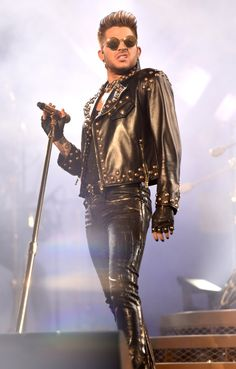 He's so sexy it hurts. Adam Lambert struts onstage during a performance with Queen on July 23 in East Rutherford, N.J.