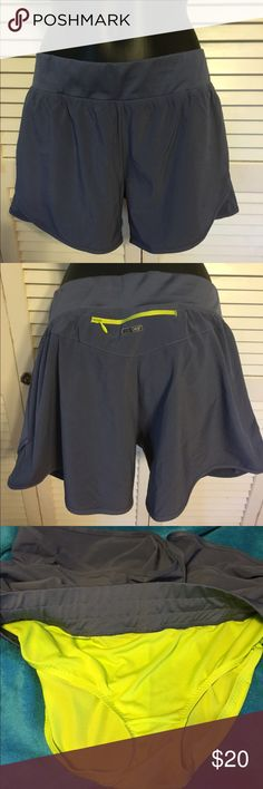 Puma Running Shorts Grey with neon yellow lined attached underwear. Zip pocket at back waist. Non roll waist band. Never worn. NWOT Puma Shorts