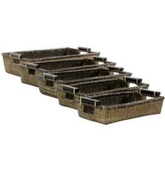 Tropical design woven trays in a set of five, crafted from fine antique stain Asian split vine rattan, with attractive dark stain wooden handles. Have breakfast in bed or tea time in the living room. With a set of five, the possibilities are endless.