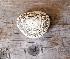 a crochet-covered stone from etsy $35/sold