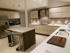 The clients wanted to create a modern and understated look for their new Elements kitchen but with a colour palette that wouldn't date over time. They particularly liked the clean lines of a handleless design and chose the Remo range in a beige finish. Contemporary quartz worktops add to the clean visual appeal and offer a very practical surface for food prep. Real Kitchen, Work Tops, Contemporary, Modern, Kitchen Design, Beige, Food Prep, Clean Lines, Furniture