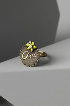 Foreign Affirmation Ring   $80.00  4.3 / 5 (3)   Style: 20193298  A wee trinket to commemorate your day. Adjustable. Bronze plated brass, enamel, resin. Handmade in France by Eric Et Lydie.
