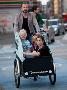 Christiania bikes are all over Copenhagen, two seats for kids and enough room left over for mom (or the groceries).